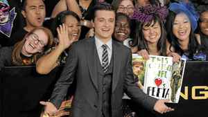 """Josh Hutcherson arrives at the world premiere of """"The Hunger Games"""" on Monday March 12, 2012 in Los Angeles."""