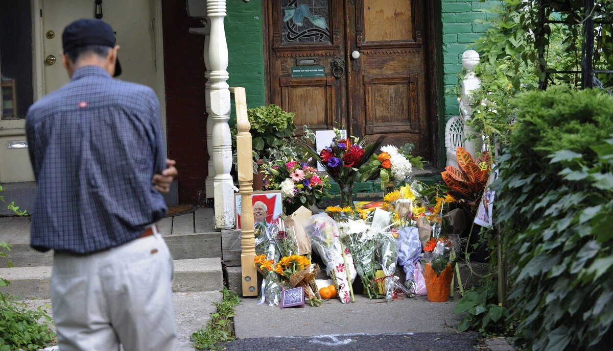 The front porch of Jack Layton's Toronto home is filled with flowers.