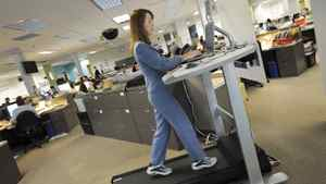 Globe reporter Rebecca Dube is photographed using a treadmill at her workstation in Toronto on Dec. 24/2007.