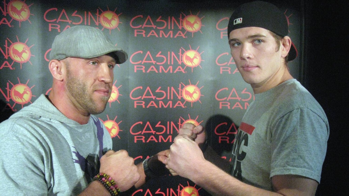 "American welterweight Josh (The People's Warrior) Burkman (left) and Jordan (Young Guns) Mein of Lethbridge, Alta., strike a pose during a news conference for "" MMA:The Reckoning,"" in Toronto, Thursday, March 31, 2011. Organizers confirmed that Saturday's show at Casino Rama north of Toronto will be seen by some 5,000."