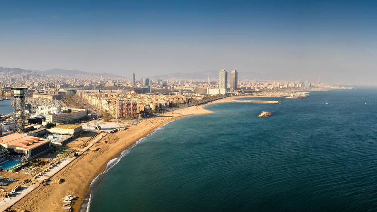 A view from the W Barcelona shows the harbour and, at middle, Barceloneta.