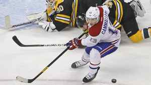 Then-Canadiens winger Mike Cammalleri looks for the puck after Boston Bruins goalie Tim Thomas made a save in the first period in Boston, Thursday Jan. 12, 2012. Cammalleri was traded midway through the game.
