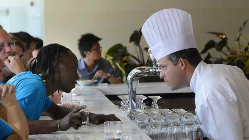 An employee asks Luma Restaurant manager and executive chef Jason Bangerter a question as Mr. Bangerter talks to staff about the art of dealing with celebrity clients and festival patrons at the Toronto International Film Festival.