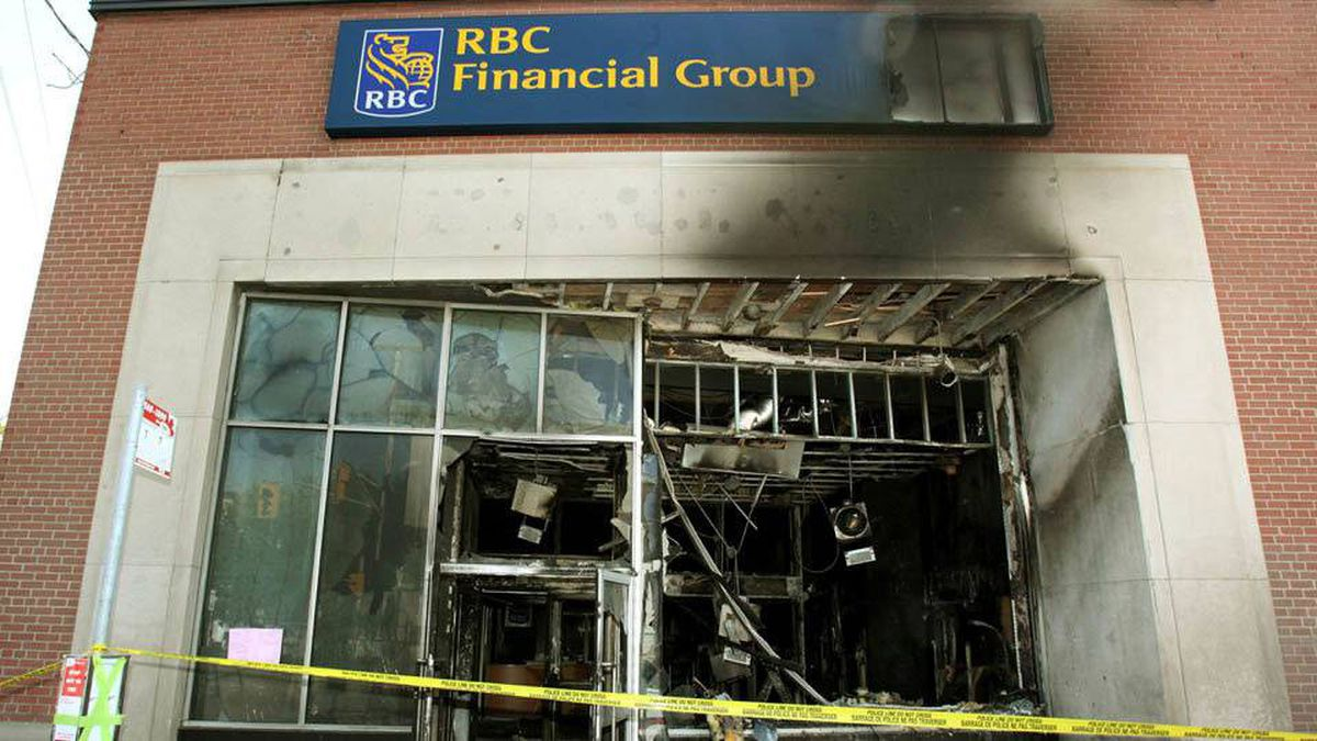 Damage is seen Wednesday, May 19, 2010 that was caused by a firebomb at an Ottawa downtown bank early Tuesday morning. Anarchists who claimed to have firebombed the bank are vowing to take their protest to the upcoming G8 and G20 summits in Ontario.
