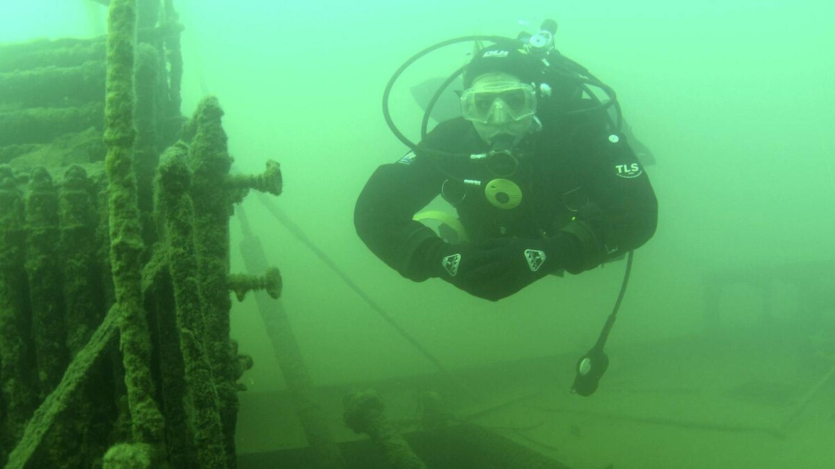 Archaeologist Lindsey Thomas hovers next the boiler on the deck of the shipwrecked steamer A.J. Goddard. Donnie Reid
