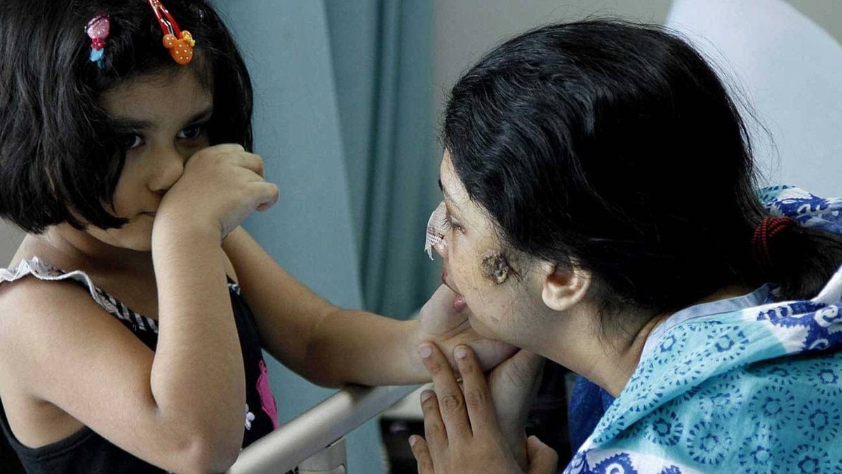 Rumana Monzur Wednesday June 22, 2011 at LabAid hospital in Dhaka with her daughter Anoushe.