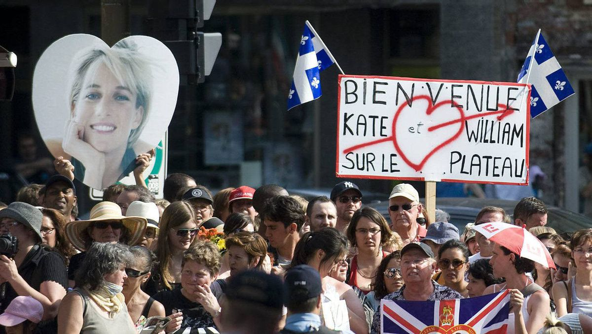 Members of the crowd smile as they wait to catch a glimpse of The Duke and Duchess of Cambridge as they visit the Quebec Tourism and Hotel Institue in Montreal, Saturday, July 2, 2011.