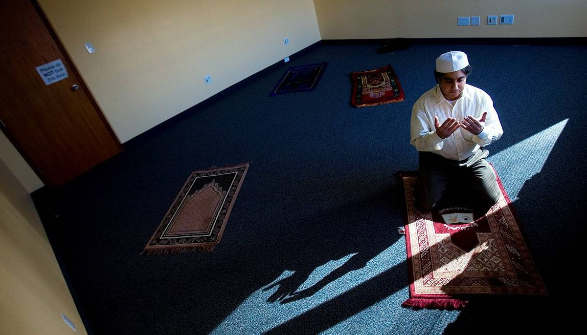 Salman Aslam, an IT software developer at Telus in Toronto, faces east for noon prayer in a room that has been set aside for employees.