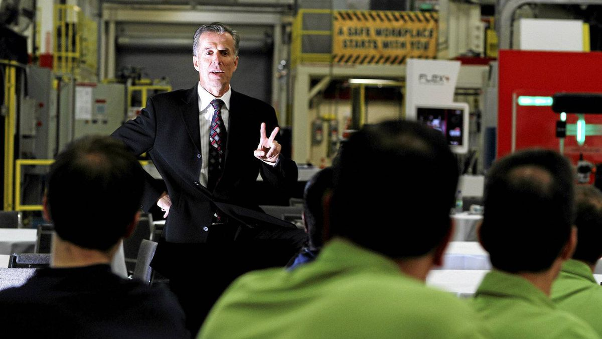 Don Walker, chief executive of Magna International Inc., talks to employees during a meeting at the Magna plant in Brampton, Ont., on Wednesday, Nov. 16, 2011.