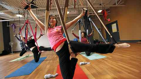 Yoga Instructor Beatrix Montanile works with her OmGym class at Hands On You in Toronto.