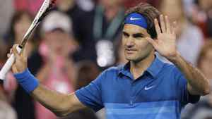 Roger Federer of Switzerland waves to the crowd after defeating Denis Kudla of the U.S. during their match at the Indian Wells ATP tennis tournament in Indian Wells, California, March 11, 2012. Federer faces Canada's Milos Raonic in Tuesday's third round match. REUTERS/Danny Moloshok