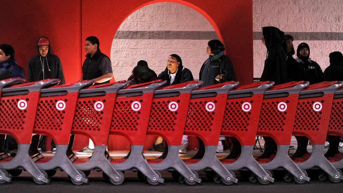 Black Friday shoppers wait for the midnight opening of an Emeryville, Calif., Target location. Target says it will oppose an attempt to have unionized workers at its Canadian stores.