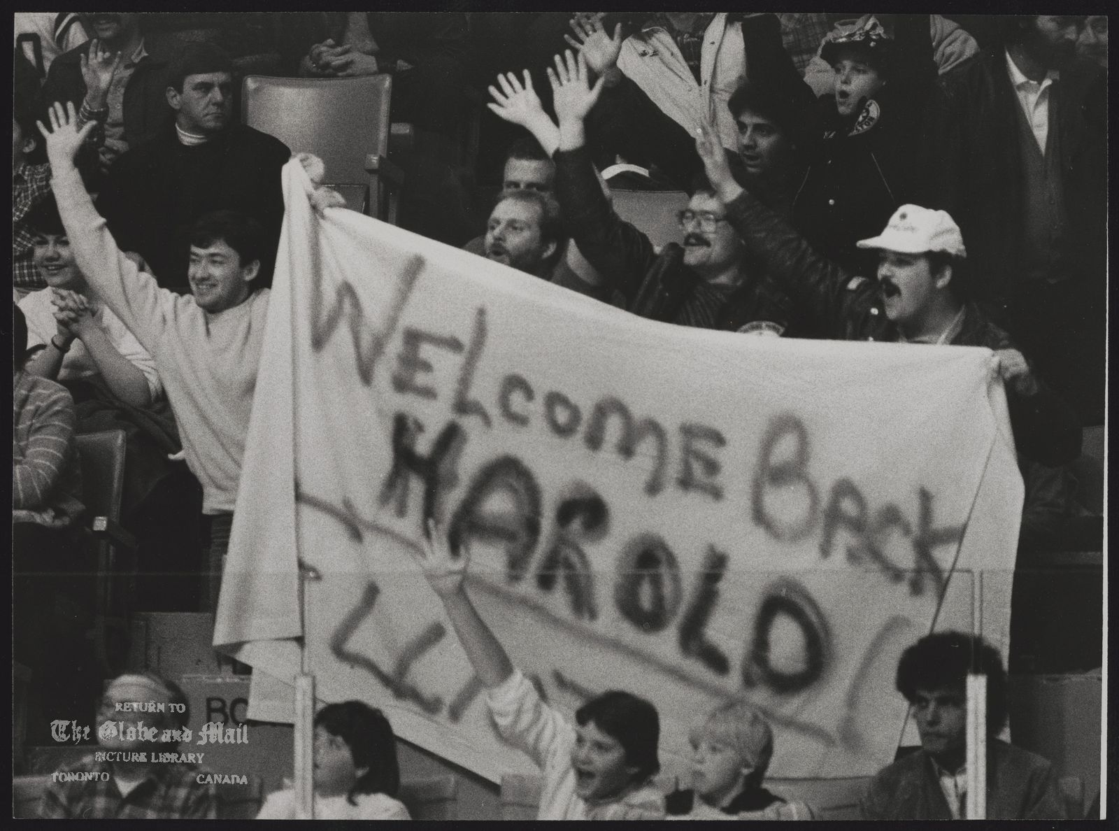 Harold BALLARD Toronto. Businessman Fans salute Leaf boss Harold Ballard, who remains as feisty as ever despite ailments.