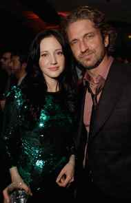 """TORONTO, ON - SEPTEMBER 12: Actress Andrea Riseborough and Actor Gerard Butler attend the """"Weinstein Party Including Butter Cast"""" hosted by GREY GOOSE Vodka at Soho House Pop Up Club during the 2011 Toronto International Film Festival on September 12, 2011 in Toronto, Canada."""