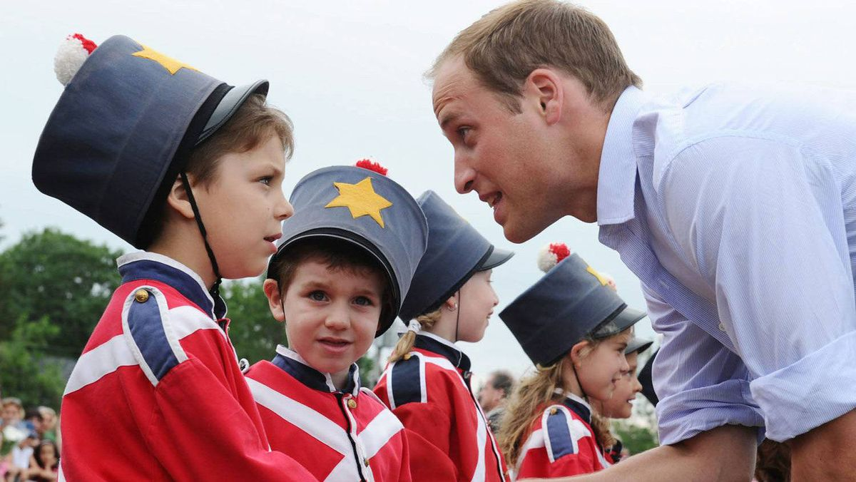 The Duke of Cambridge inspects a group of children dressed as British soldiers as he and the Duchess visit Fort Levis in Levis, Quebec on Sunday, July 3, 2011.