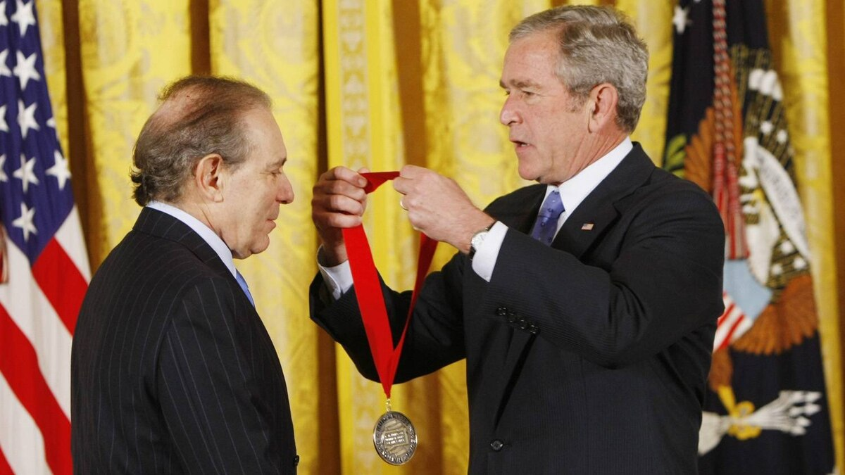 In this Nov. 15, 2007 file photo, President George W. Bush, right, presents the 2007 National Humanities Medal to Roger Hertog during a ceremony in the East Room of the White House in Washington. Hertog posted the $2 million bond for Conrad Black on Wednesday July 21, 2010.