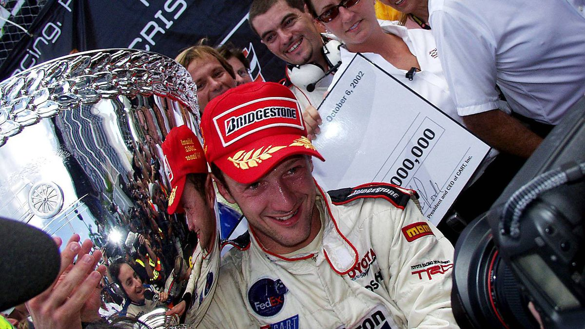 2002 Grand Prix Americas Cristiano da Matta poses with the Vanderbilt Cup. He took the chequered flag on the streets of Miami, Fla., winning for the seventh time in 16 starts to clinch the Champ Car title with three races to go.