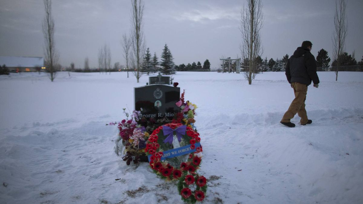 Cpl. Jesse Starko walks away from the gravesite of friend and colleague Sgt. George Miok at the Our Lady of Peace cemetery in Edmonton Dec. 10, 2010.