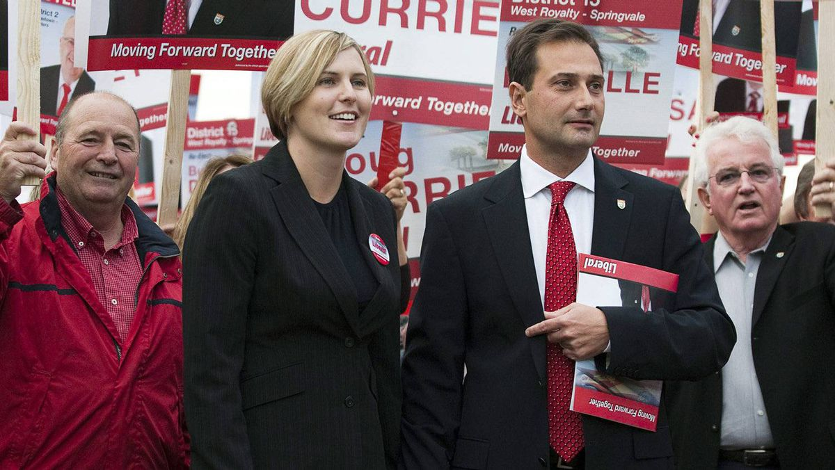 Premier Robert Ghiz and his wife Kate Ellis Ghiz arrive at a leaders' debate for the Prince Edward Island provincial election in Charlottetown on Thursday, Sept. 22, 2011.