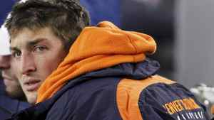 Denver Broncos quarterback Tim Tebow sits on the bench in the second quarter against the New England Patriots during their NFL AFC Divisional playoff football game in Foxborough, Massachusetts, January 14, 2012. REUTERS/Jessica Rinaldi