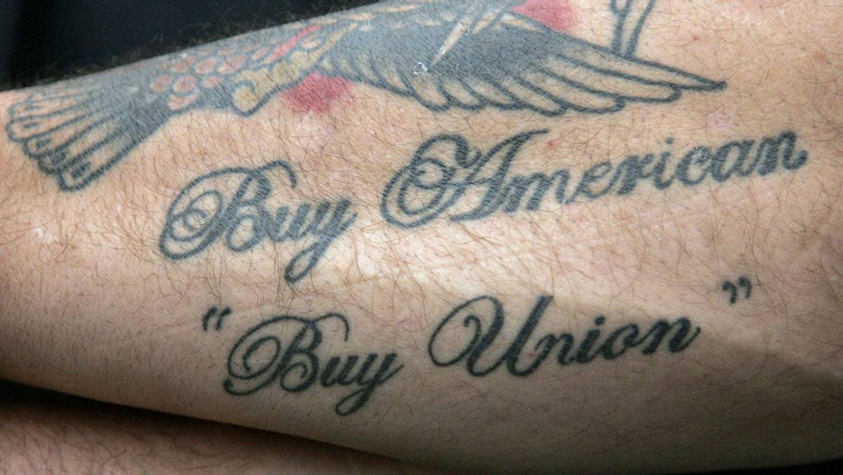 A United Auto Workers union member shows off his 'Buy American' tattoo in Canton, Mich., on June 2, 2009.