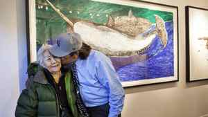 TORONTO: November 6, 2011 -- Artist Kenojuak Ashevak (left) receives a kiss from her nephew Tim Pitsiulak during a show featuring his art at Feheley Fine Arts in Toronto. Photo by Della Rollins for The Globe and Mail