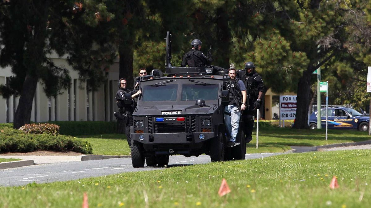 Police officers on an armoured vehicle survey the scene of a shooting at Oikos University in Oakland, Calif., April 2, 2012.