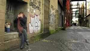 A aboriginal prostitute smokes some crack in Vancouver's lower East side February 8, 2002. Police are investigating the house and surrounding farm as part of their investigation into the disappearance of up to 50 woman.