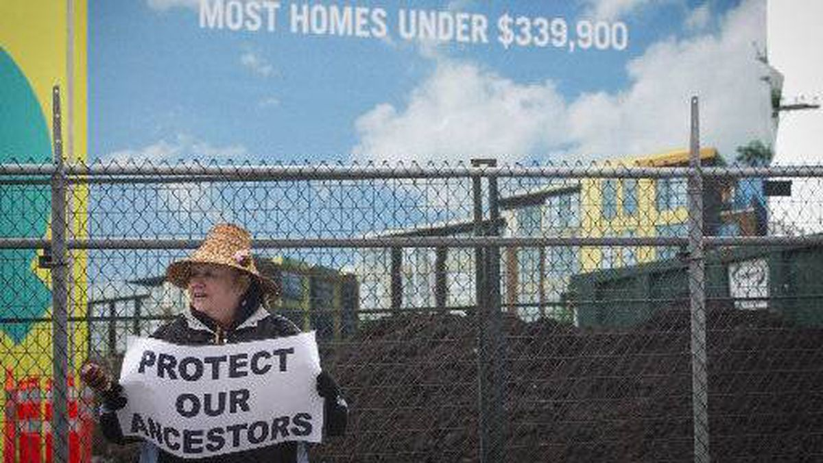 Louise Point from the Musqueam Indian band stands outside of a condominium development on ancestral burial grounds of the Musqueam in Vancouver on March 13, 2012.