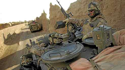 Canadian soldiers drive their Light Armoured Vehicle near the town of Howz-e-Madad in the Panjwaii district of southern Afghanistan in December of 2006.
