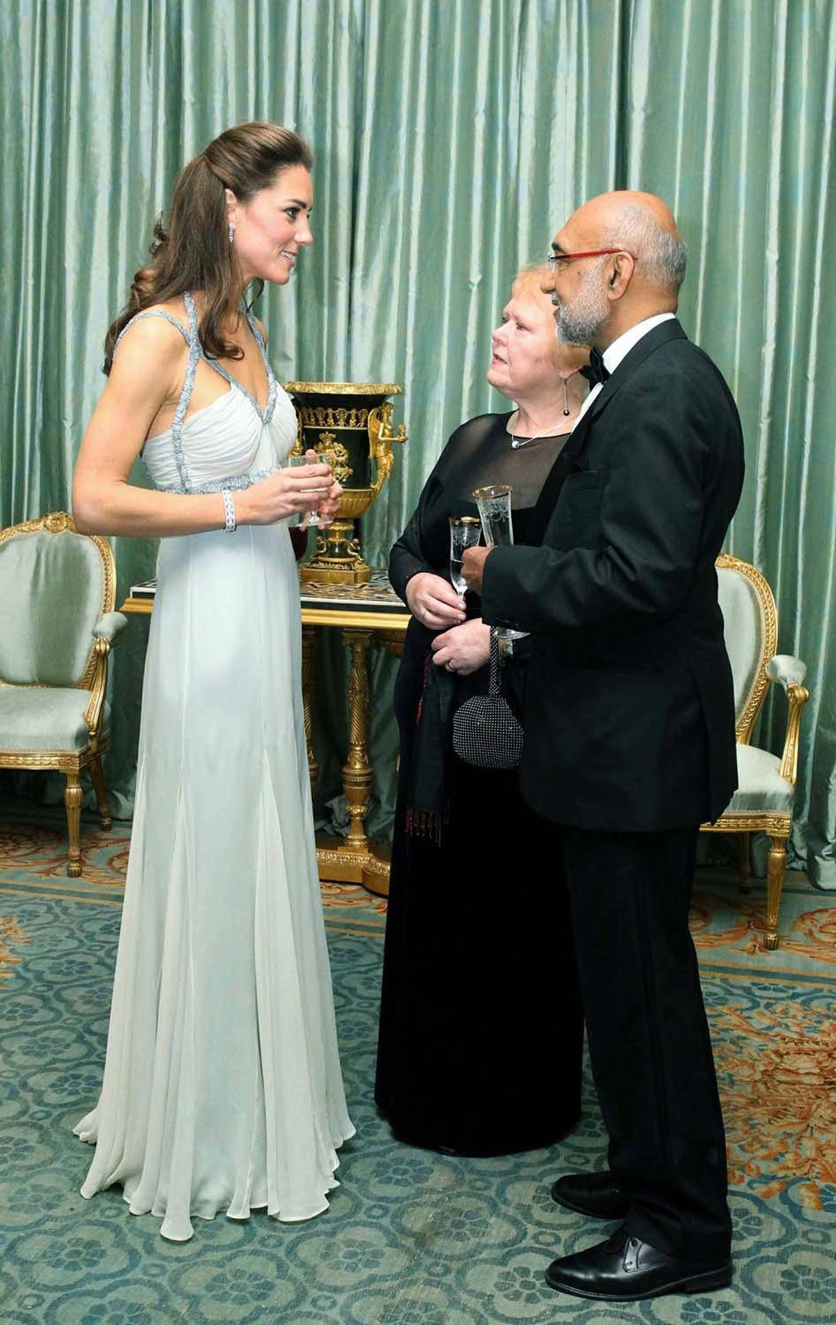 The Duchess goes with a pale colour for once, greeting guests at London's Clarence House in mint-green gown by Amanda Wakeley on October 27.