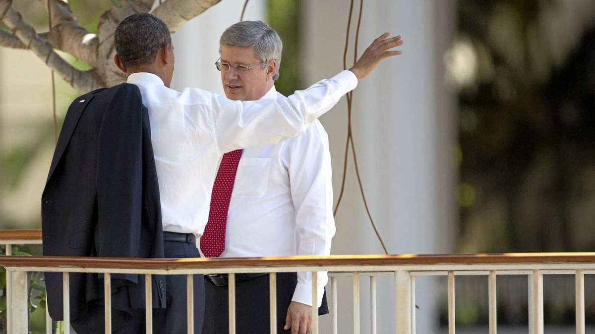 President Barack Obama talks with Canadian Prime Minister Stephen Harper during the Asia-Pacific Economic Cooperation (APEC) summit at the J.W. Marriott Hotel on Nov. 13, 2011 in Honolulu, Hawaii.