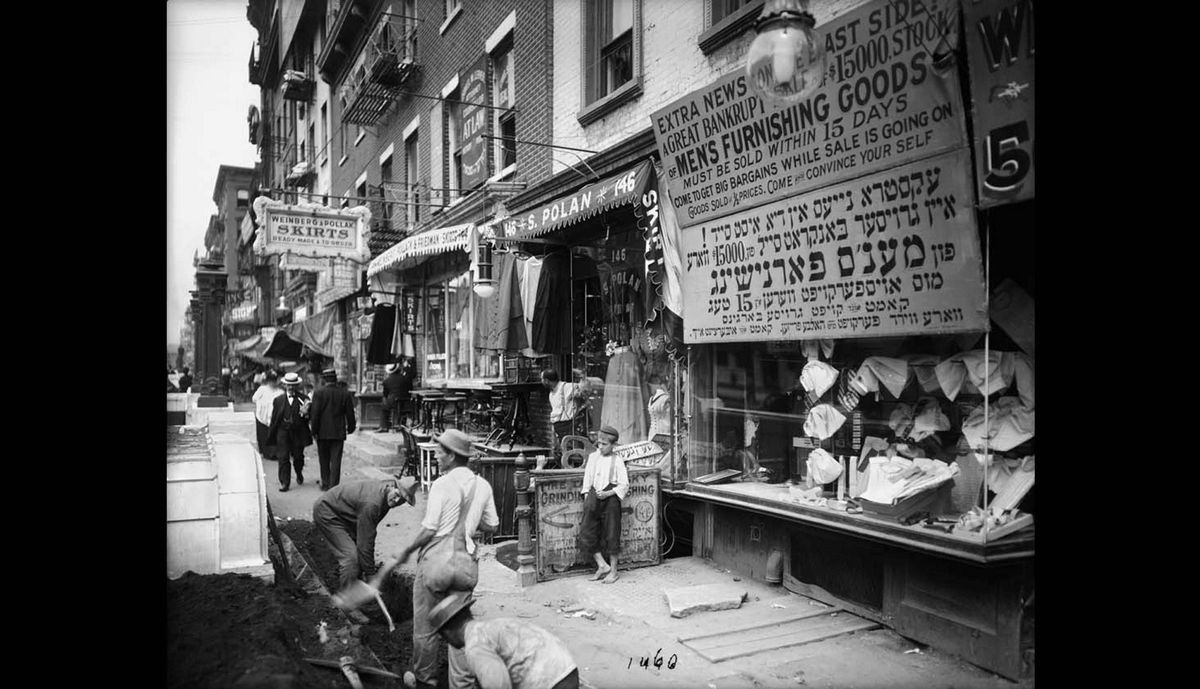 In this July 29, 1908 photo provided by the New York City Municipal Archives, workers dig in the street along the sidewalk on the north side of Delancey Street in New York.