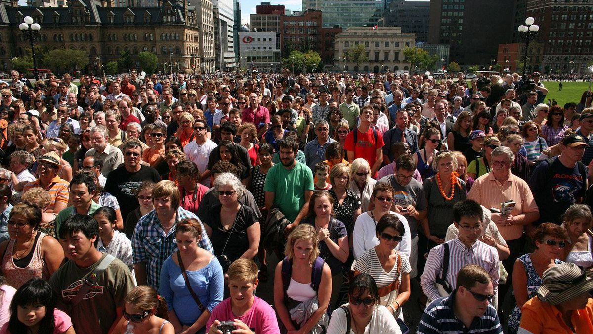 August 25, 2011: Mourners gather on the front steps of Parliament Hill to bid farewell to NDP leader Jack Layton in Ottawa.