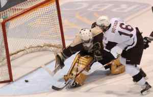 Manitoba Bisons goaltender Steve Christie wasn't quick enough to stop the puck from Saint Mary's Huskies' Andrew Hotham as he slides in a goal one in minutes into the second period at the CIS Cavendish Cup hockey action in Thunder Bay, Ontario on Saturday March 27, 2010. THE CANADIAN PRESS/Sandi Krasowski