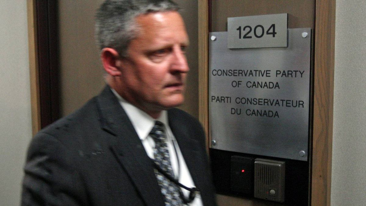 A security guard patrols the hall outside Conservative Party headquarters in Ottawa after a suspicious package was delivered on May 29, 2012.