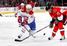 Michael Cammalleri of the Montreal Canadiens tries to chip the puck past Erik Karlsson of the Ottawa Senators in a game at Scotiabank Place on Saturday.