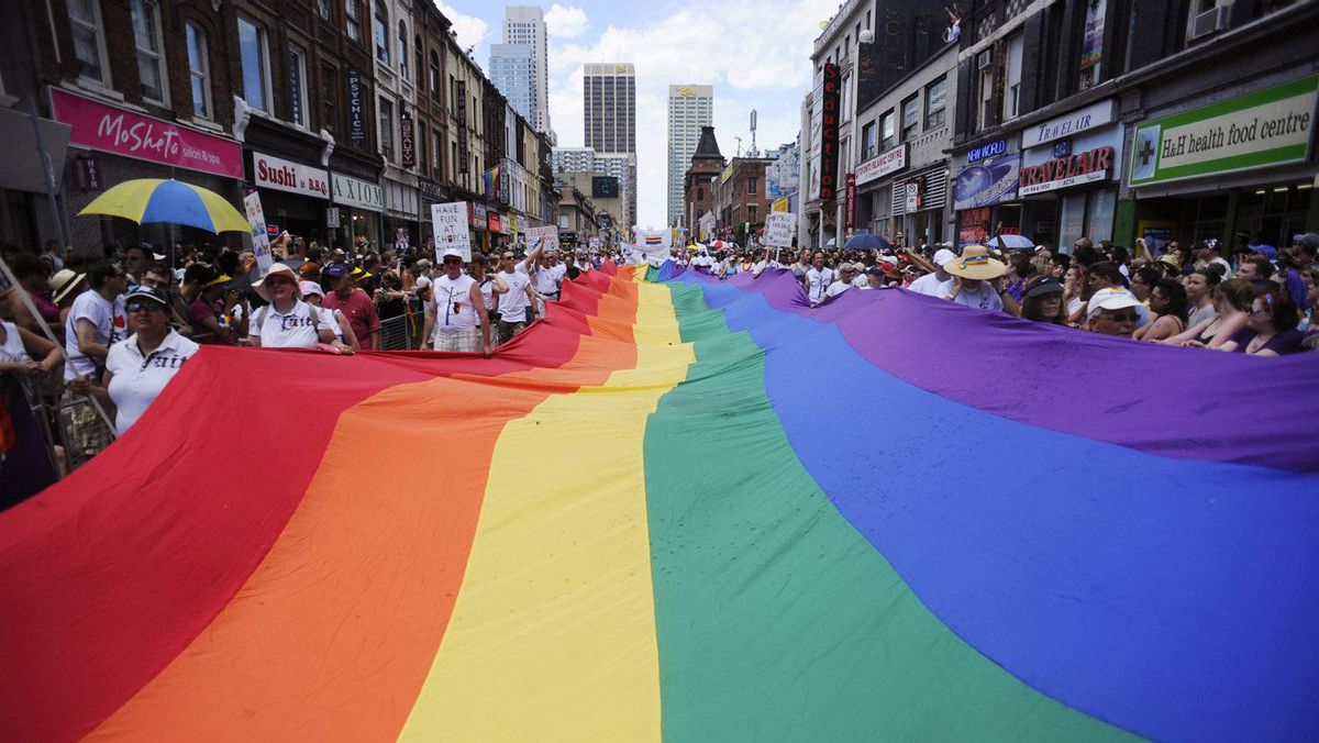 People take part in the annual Pride Parade in Toronto on Sunday, July 3, 2011.