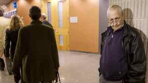 Lung-cancer victim Jean-Yves Blais (R) waits for the start of his class-action lawsuit against Canada's three main tobacco companies in Montreal, March 12, 2012.
