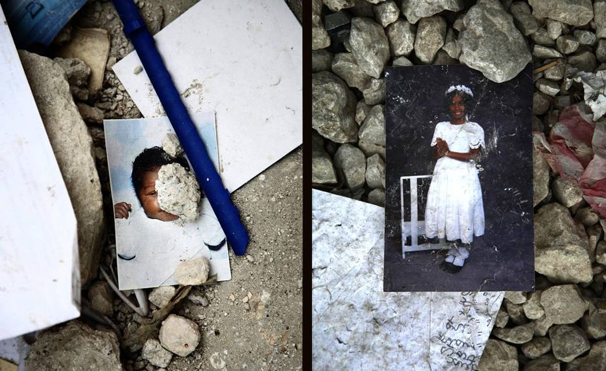 Pictures of children can be seen in the ruins of College La Fraternite, a school that collapsedin Petronville, killing 14.