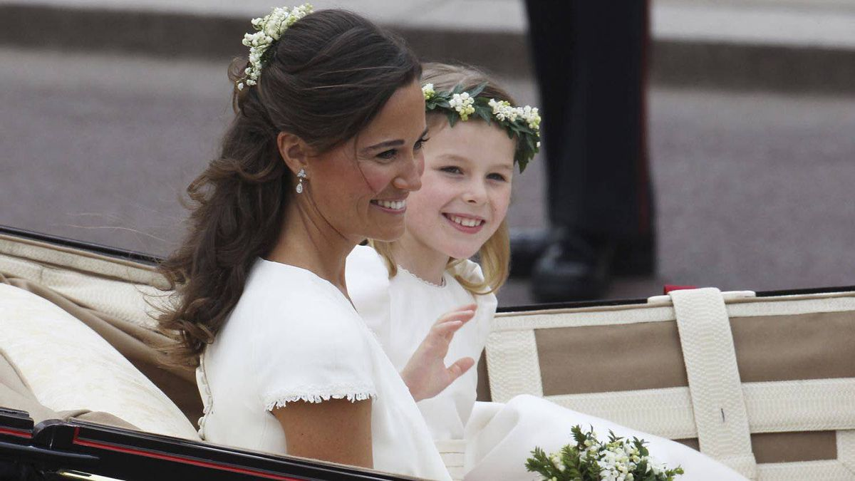 Sister of the Bride and Maid of Honour Pippa Middleton and bridesmaid Margarita Armstrong-Jones make the journey by carriage procession to Buckingham Palace following the Royal Wedding of Prince William, Duke of Cambridge and Catherine, Duchess of Cambridge at Westminster Abbey on April 29, 2011 in London, England.