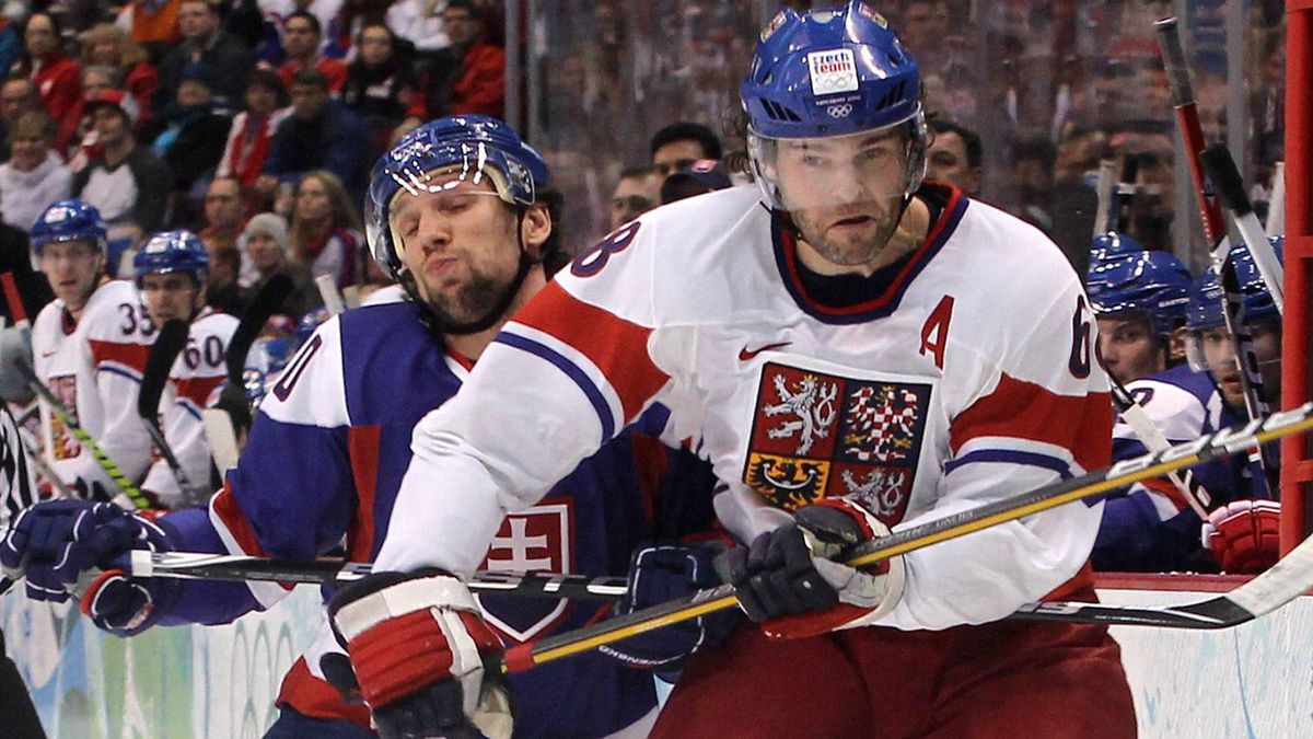 Jaromir Jagr of Czech Republic elbows his way past Richard Zednik of Slovakia at Canada Hockey Place during the Vancouver 2010 Winter Olympics. Bruce Bennett/Getty Images