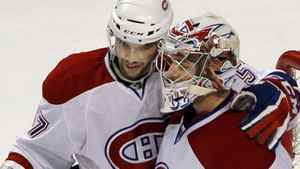 Montreal Canadiens left wing Benoit Pouliot (L) and goaltender Carey Price congratulate each other after beating the Boston Bruins in Game 2 of their NHL Eastern Conference quarter-final hockey game in Boston, Massachusetts April 16, 2011. REUTERS/Brian Snyder