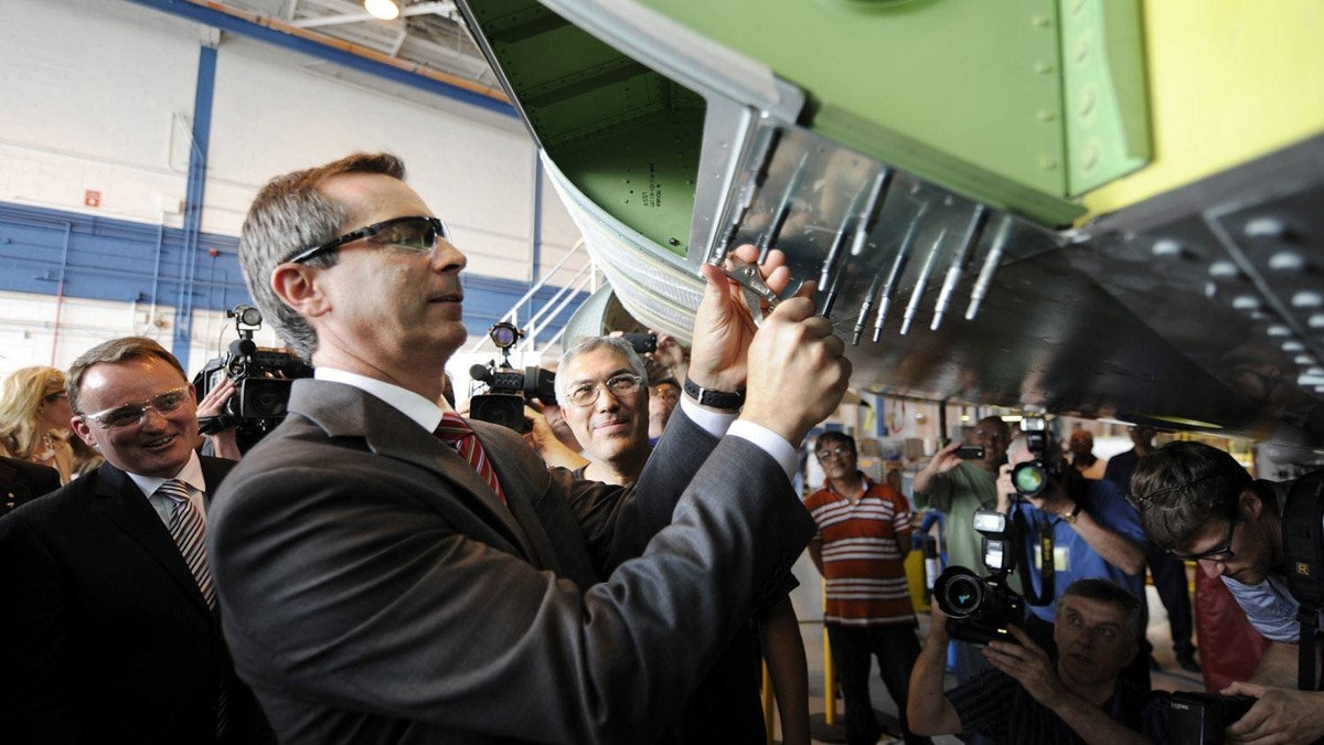 Ontario Premier Dalton McGuinty tries his hand at assembling part of the Global Express jet on Tuesday. The premier was touring the Downsview plant to mark the 20th anniversary of Ontario operations.