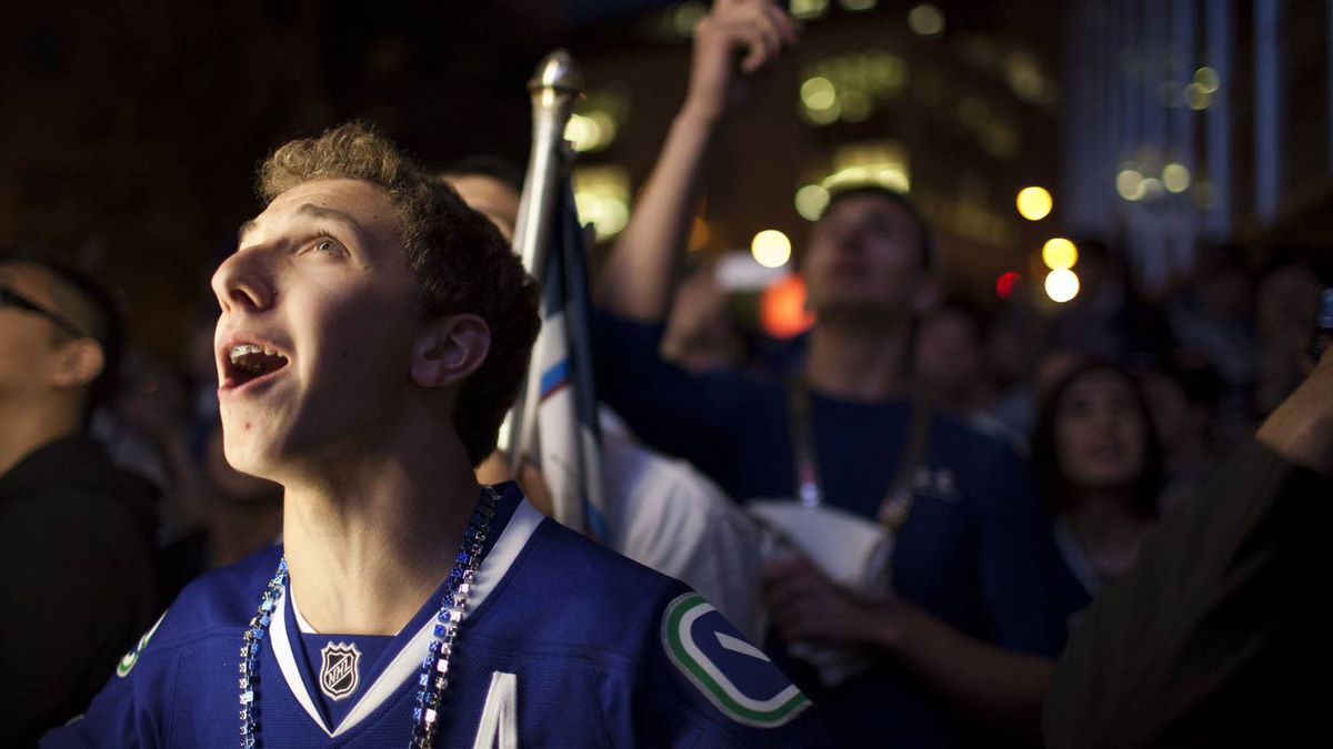 Fans celebrate the Vancouver Canucks' Game 5 win against the San Jose Sharks, at CBC plaza in Vancouver. Rafal Gerszak for The Globe and Mail