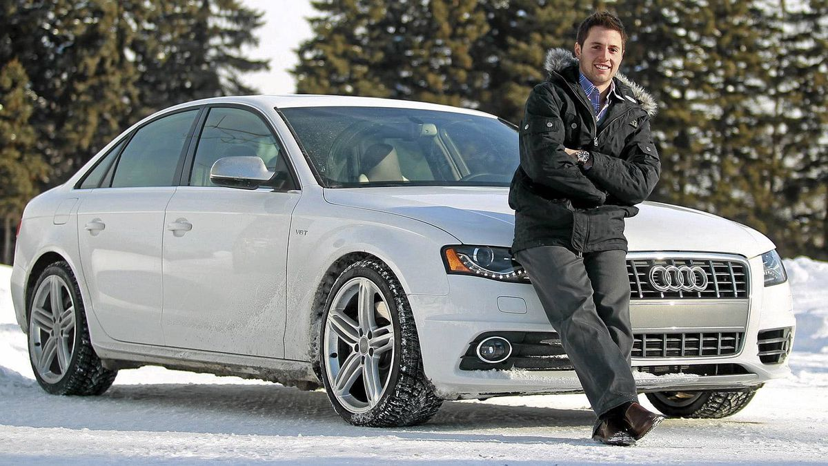 Gold medalist Alexandre Bilodeau poses with his car, the 2011 Audi S4, in Montreal, Quebec on February 10, 2011. (Christinne Muschi for The Globe and Mail)