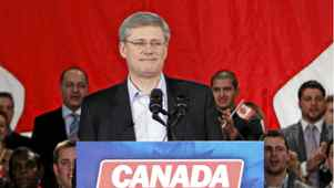 Canada's Prime Minister Stephen Harper pauses before speaking at a rally to celebrate the fifth anniversary of the Conservative parties minority government in Ottawa January 23, 2011.