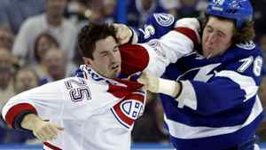 Montreal Canadiens' Brad Staubitz (25) and Tampa Bay Lightning's Pierre-Cedric Labrie (76) fight during the third period of an NHL hockey game on Tuesday Feb. 28, 2012, in Tampa, Fla. The Lightning won the game 2-1.