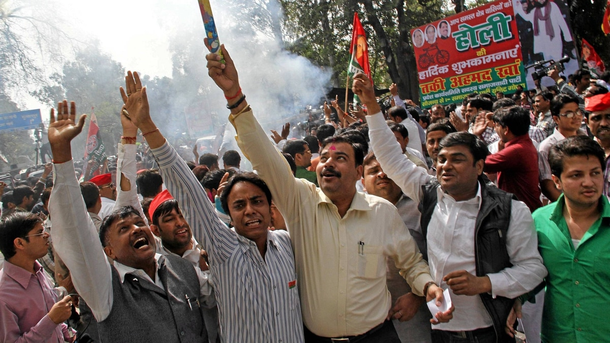 Supporters of Samajwadi Party (SP) celebrate outside their party's headquarters in the northern Indian city of Lucknow March 6, 2012.