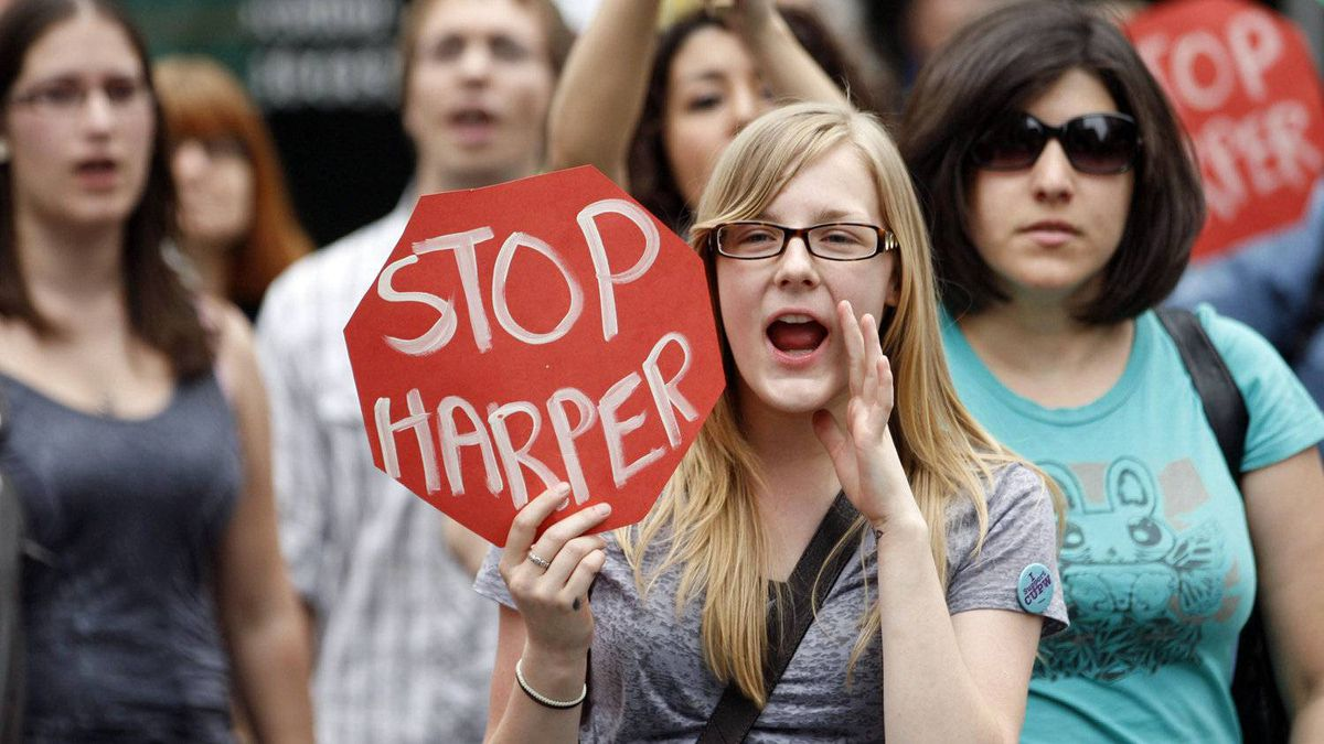 Anti-Harper demonstrators protest outside the Conservative Party convention in Ottawa on June 10, 2011.